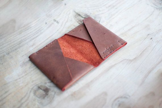 A simple wallet with minimalistic design made in one single piece. It has 4 separate pockets for cards and folded money, thanks to the design you can use this product as a wallet or just a cardholder. The pictures of this listing show the inside of the wallet with a nice dark red. You can customize your own and ask for natural or red inside colour.   For a different version of this wallet / cardholder visit this listing: http://etsy.me/2bTosmt   - THE LEATHER -  Leather is...