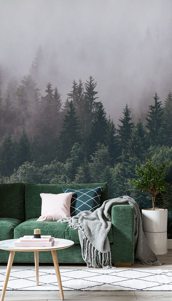 Time to unwind? Put your feet up surrounded by immense greenery with this captivating forest wallpaper mural. Gaze upon crisp, defined treetops while you sink deeper into the sofa. Pair with pastel pink elements to soften the look.