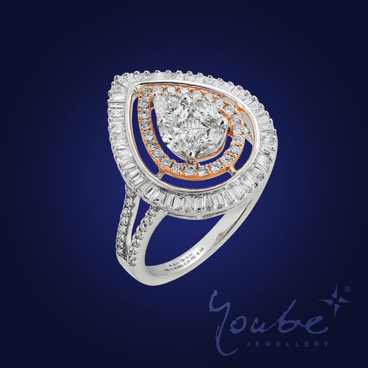 A diamond is a precious gift, a treasure that will withstand the test of time. This ring is set with illusion setting with pear and marquise shaped diamond making it an unforgettable work of perfection!