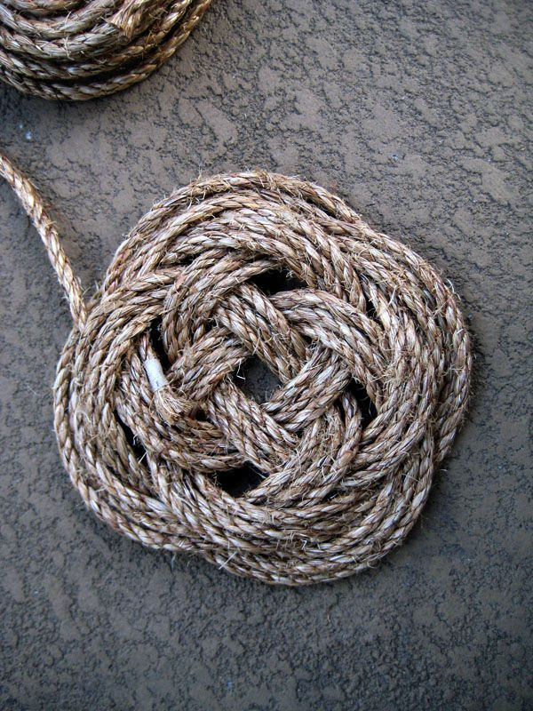 "DIY Carrrick Bend Mat by instructables: When formed flat, a Turk's Head Knot it is called a Carrick Bend Mat.  When ""morphed"" into a round pattern it is called the Boy Scout Woggle. via http://www.morethanknots.com/TURK_HEAD_DEF.html"