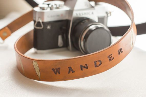 "Handmade leather camera strap with the word ""wander"" for the travel minded photographer or free spirit. Made by Wander + Whim Supply."