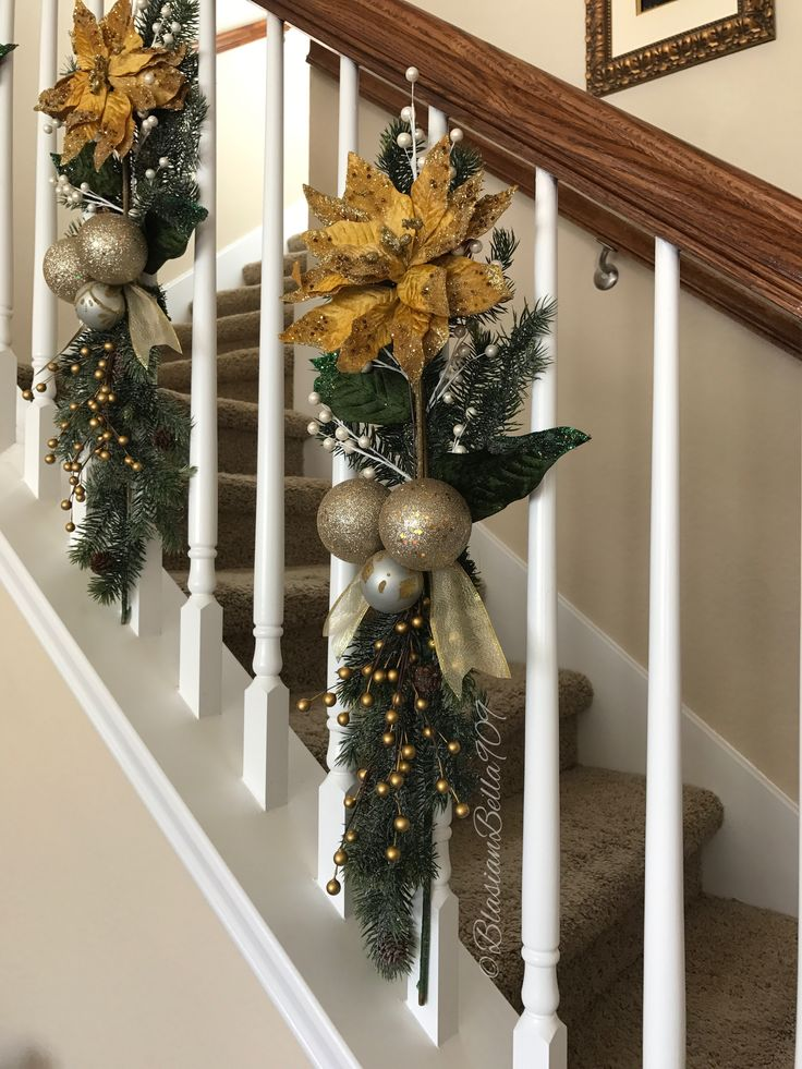 Handcrafted greenery and floral swags decorated on the staircase banisters which free up the rails to use.  #Christmas #holiday #home #stairwell #staircase #decor #decoration #greenery #swag #DIY