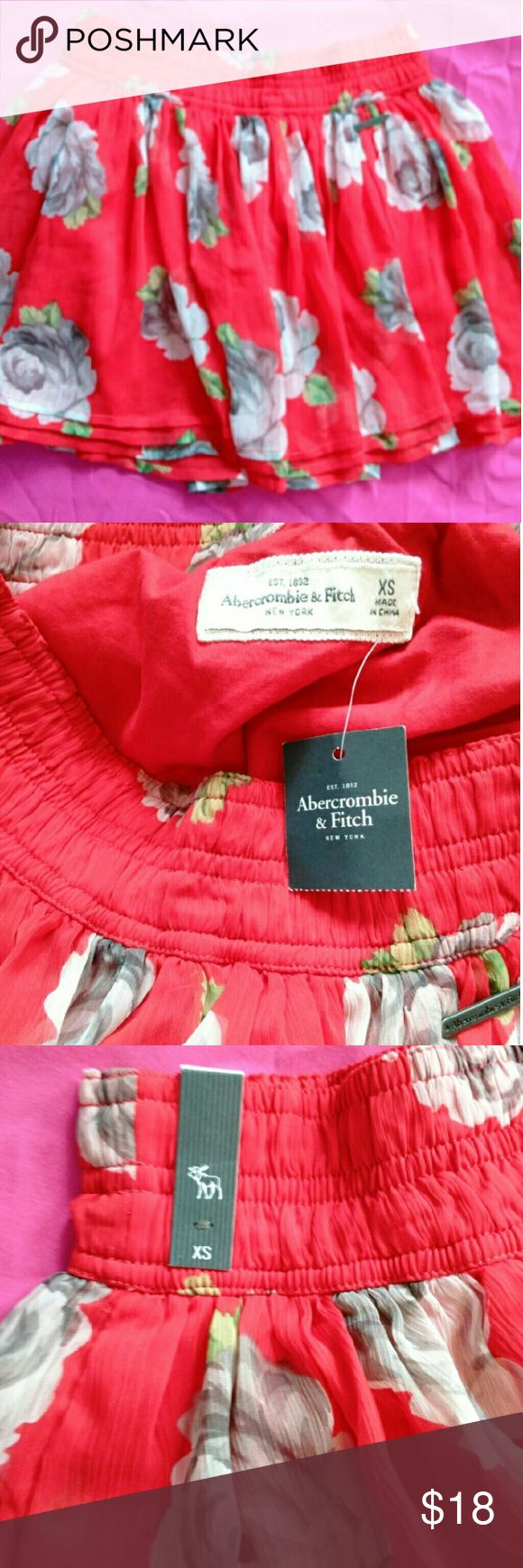 Abercrombie & Fitch skirt, NWT New with tags, Abercrombie & Fitch red skirt with flowers, size XS. Very cute skirt. Abercrombie & Fitch Skirts Mini
