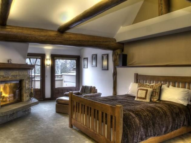 Bruce Willis' Idaho Home: Master Bedroom The master suite boasts a gas fireplace, a cozy seating area, two heated decks, a built-in desk and bookshelves.