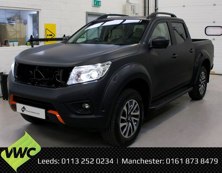 Blacked out Nissan Navara fully wrapped in the 3M Matte Black, including the door shuts along with some orange decals. #3M #3MMatteBlack #Wrapping #Nissan #Navara #NissanNavara #VehicleWraps #CarWrap #matteblack #vinylwrap #Leeds #Manchester #TheVehicleWrappingCentre #VWC #4x4 #layednotsprayed #vinyl 3MWrapsUK
