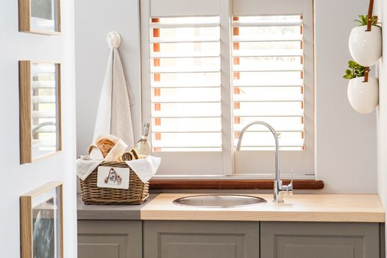Mini Kitchenette with a welcome basket, white shutters and other Rhino themed decor pieces #Kitchen #Shutters #Apartment