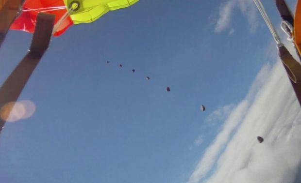 """Multiple frame picture of a meteoroid falling? Taken from the helmet camera of a Norwegian skydiver who was narrowly missed by the rock. Coming so close to April 1st, it sounds like a slightly belated April Fool. Experts examined video footage and said it was consistent with a meteoroid. But later it looked more likely that it was a piece of gravel in the parachute. (Credit & copyright: Anders Helstrup) Mona Evans, """"Astronomy April Fools"""" http://www.bellaonline.com/articles/art183019.asp"""