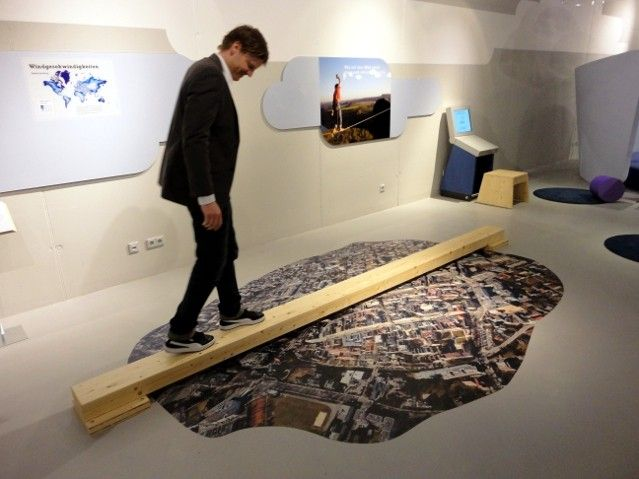 Simple play in exhibition space.  I like this for kids, especially as a way to use aerial photos, but it's not a universally accessible display, and many people would be left out. Use if there's also an alternative for people with mobility/sight/balance difficulties?