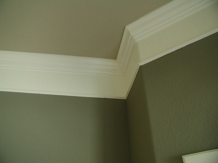 Fake crown molding... Baseboard large on top. Gap in middle (painted white) and small baseboard at bottom.. Cheap
