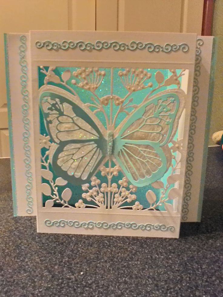Made by Angela Long - Made with couture creations butterfly dies and tattered lace mini border die and added nuvo pearls and glitter