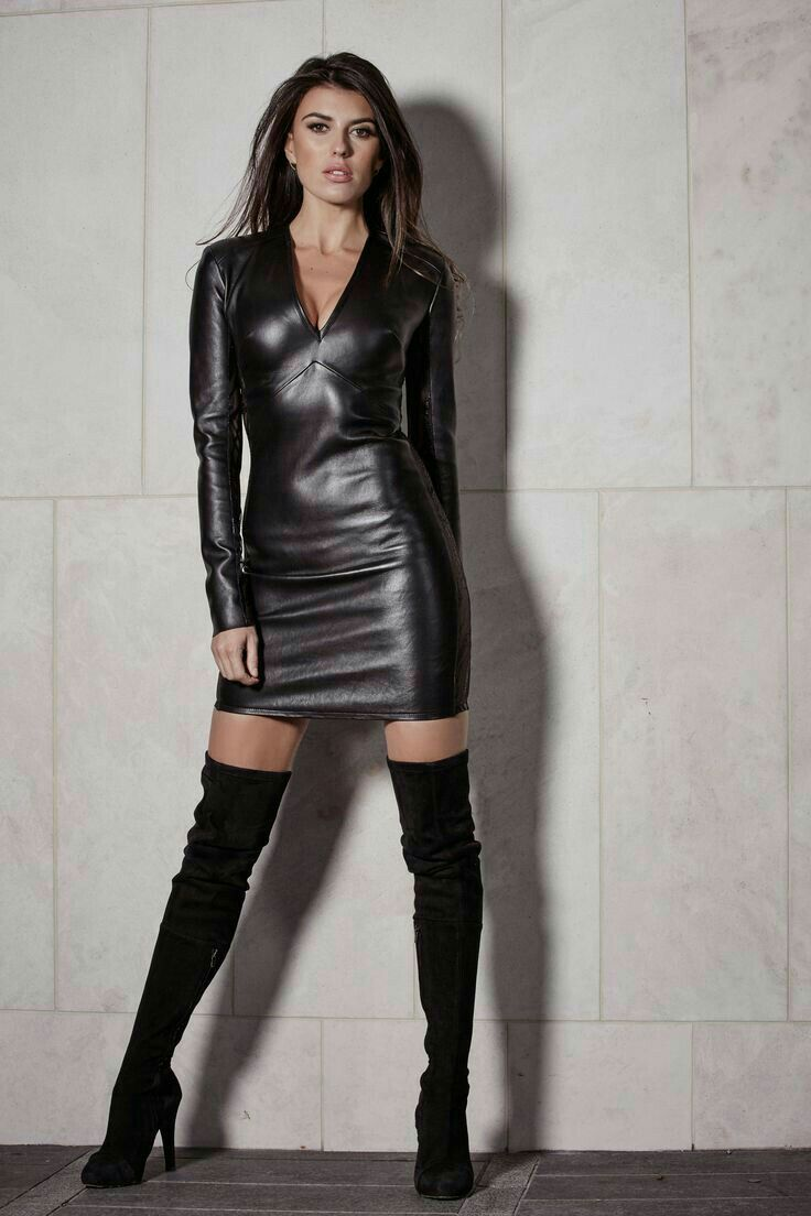 Black leather minidress and thigh boots