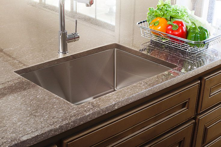 A Franke stainless steel sink is the base of a perfect kitchen workstation!
