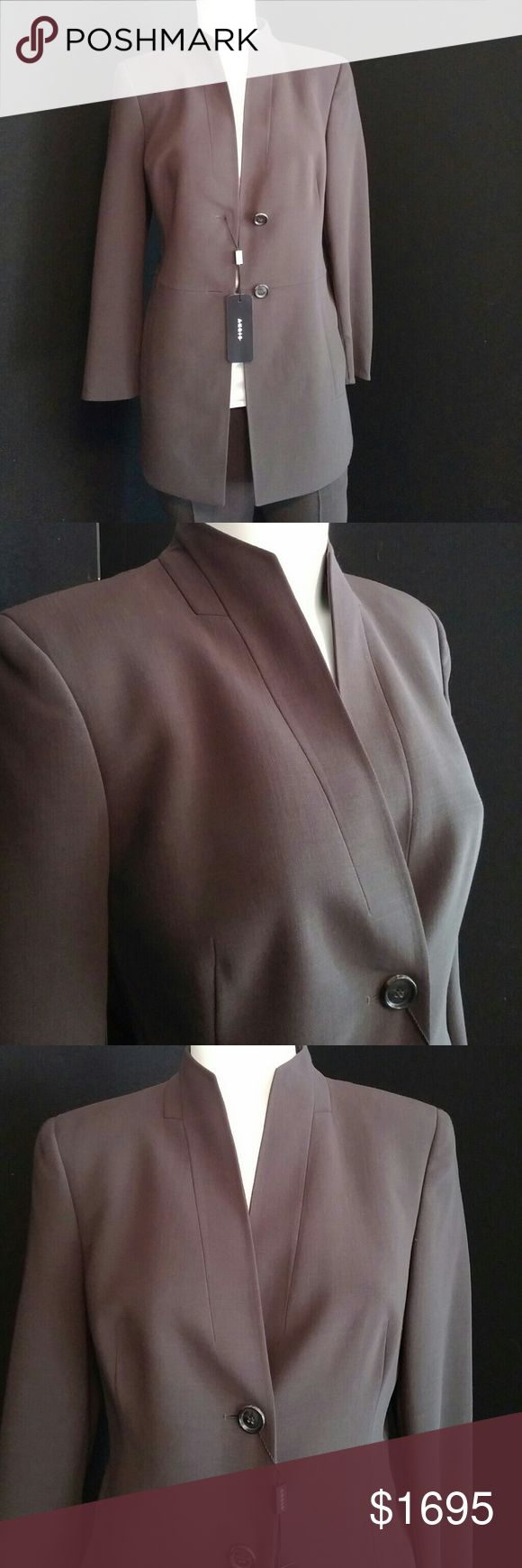NWT Beautiful AKRIS mocha colored jacket This jacket is absolutely stunning. Long lovely lines make 4 a very slimming look. Comfortable fabric, two button with pockets. Jacket is size 6. It Retails for $3700. I also have pants listed that match in a size 4. Pants retail at $895. Please see listing. I will discount suit if you buy both items. Both items are new with tags. A very classic suit you can keep forever. Akris Jackets & Coats