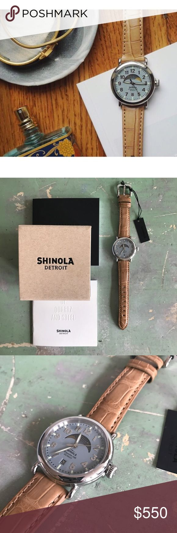 Shinola Runwell Watch Built in Detroit. Shinola 36mm Runwell Moon Phase watch. Features slate blue dial and 100% genuine American alligator tan strap. Argonite-708 movement includes a sweeping second hand, date, and moon phase tracker. The screw down crown assists in water resistance up to 5 ATM. Package includes a small paper box, user manual, and booklet about manufacturing in Detroit. Watch has been worn a handful of times. Very minimal scuffing on the edge of the stainless steel case…
