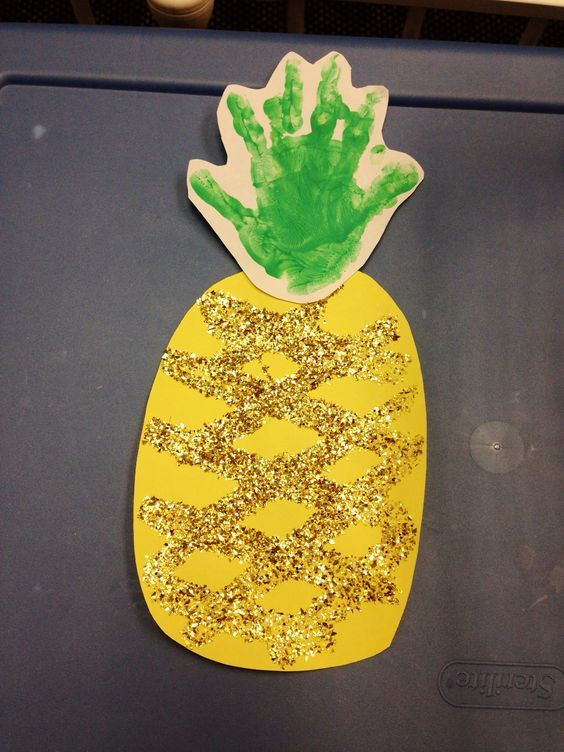 Pineapple for Hawaiian theme - green handprint for the leaves. I used green glitter instead of the gold