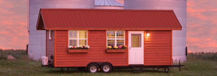 ESCAPE Vintage is a stunning handcrafted tiny home on wheels that's built like a cottage but classified as a Park Model RV.