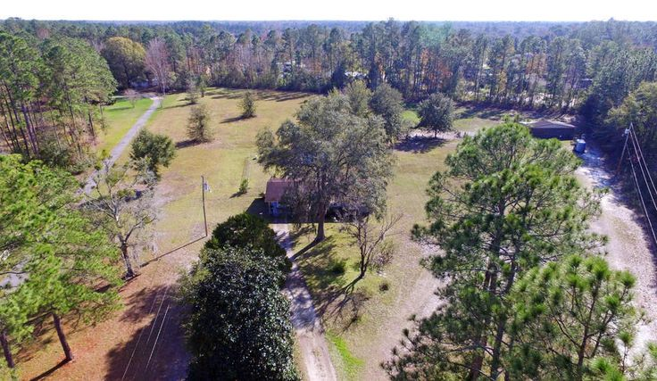 6 acres of prime ... real estate with road frontage on CR220. Check out Brann Field Master Plan Community Land Use Review MPC. 3 bedrm home with 1.5 baths has a family room,laundry outside in it's own building and pasture with small barn for your horses. Listing agent has a familiarity relationship with the seller.