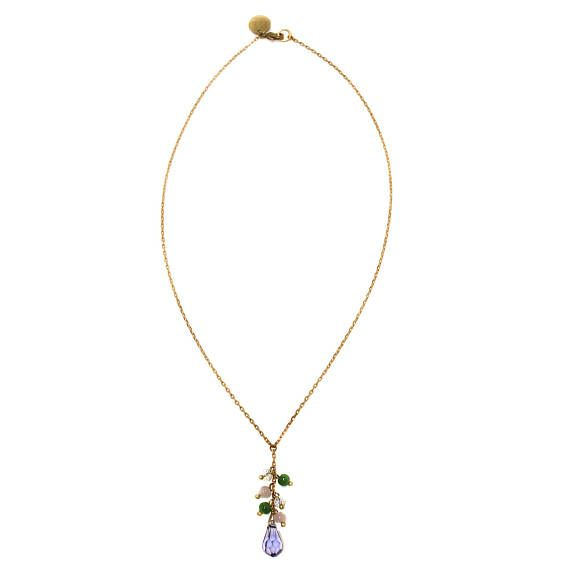A very elegant and pretty short lariat style necklace - inspired by Bvlgari gemstone colours and design as well as English gardens and dreamy, swaying bluebell fields. The central drop is lavender faceted Swarovski crystal with lots of sparkle, accented by pale rose, emerald green and aurora borealis round beads in a classic grape cluster style. The necklace measures approx. 21cm each side, the lariat drop including beads is approx. 4cm long.  Lobster clasp closure with hand stamped tag…