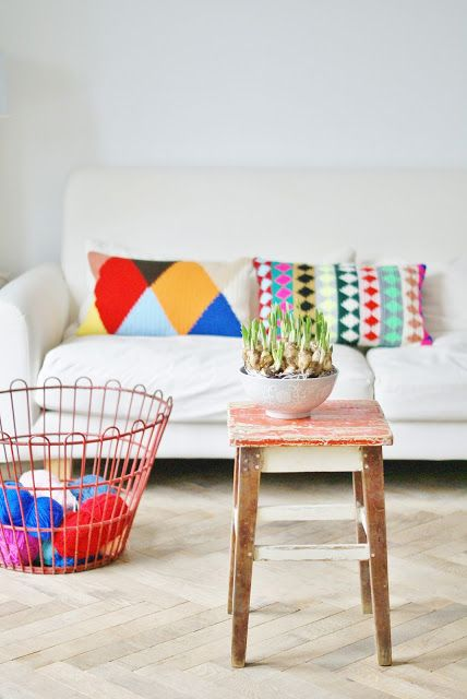 wood & wool stool. Cushion love. Coloured wire basket love. Stool love. But the white couch is never going to happen