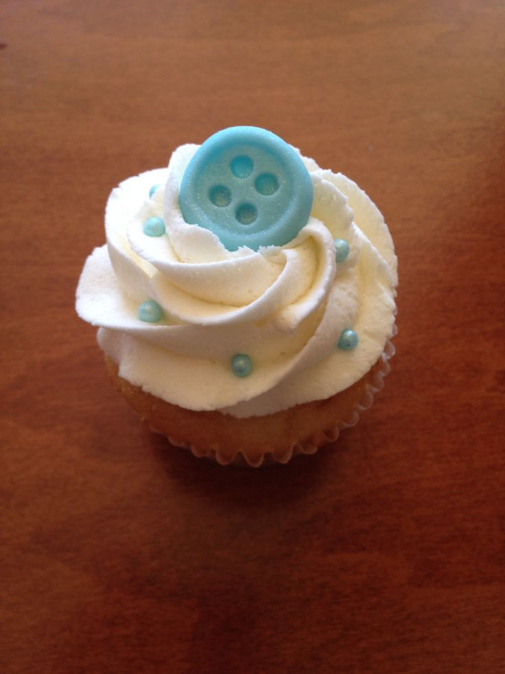 cute as a button theme for a baby shower cupcake idea