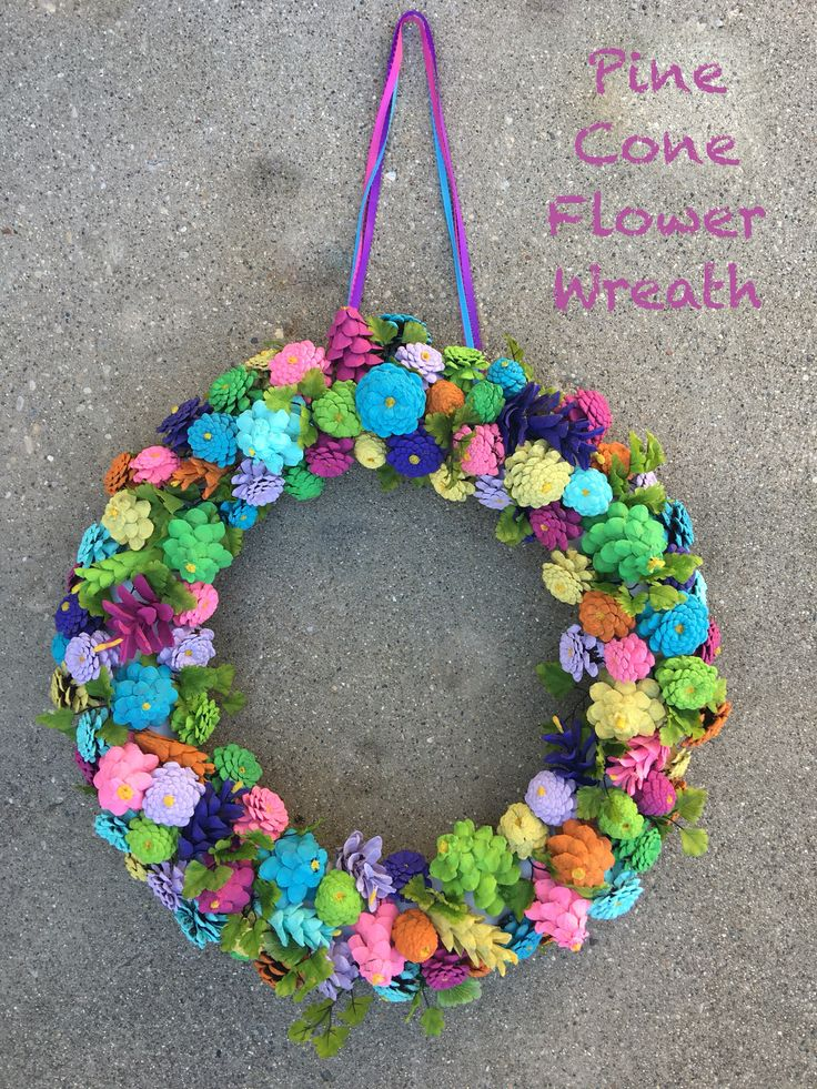 Pine cone flower wreath that I made from large and small pine cones. I painted them with acrylic paints, added string (for hanging) to a styrofoam wreath, hot glued the pine cones to the wreath. Finish with an acrylic gloss or Polycoat. I also hot glued some silk leaves to it.