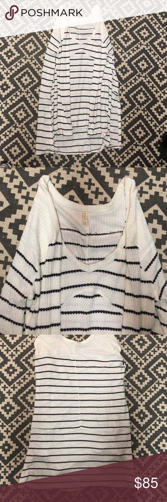 free people long sleeve shirt / tunic never before worn (brand new) free people black and white striped shirt / tunic. women's size large. great for layering or worn with jeans or leggings. just too big for me. Free People Tops Tunics