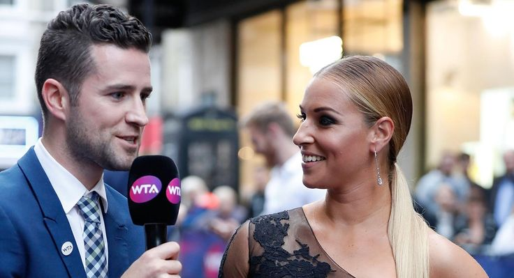 Dominika Cibulkova is interviewed by Nick McCarvel on the purple carpet at the WTA Pre-Wimbledon Party. (Getty)