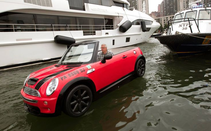 "MINI Cooper boat.   Posted on 05.11.2013  A boat based on the Cooper Convertible. This special Cooper will be ""driven"" on the Schuylkill River 5/10&11. The boat was built as a 1-of-a-kind project developed for MINI USA's Not Normal event. The boat is a fiberglass mold mounted to a boat hull. It comes with authentic Mini parts; headlights, taillights, grille, steering wheel, badges, wheels and tires.  The Mini boat was constructed by ACI Composites Inc., of Lancaster, Pennsylvania."