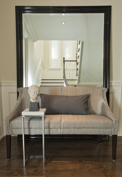 I love the idea of pulling a small cocktail table or tray table up to an entry settee. If you're lounging with a book or chatting with a friend, you have an instant spot to set a cup of coffee or another drink, and the table also can serve as a perch for a handbag, gloves or a parcel as you prepare to head out the door.