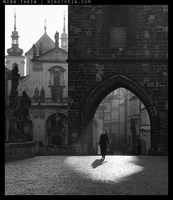 From The Arches of Prague. Very, very few lenses maintain that kind of contrast and shadow separation when faced with such intense backlight, and very few cameras can hold that dynamic range (almost nothing is actually clipped in this image, making for a very natural tonal transition in the print) – cue the Otus 85 and D810.  Image by Ming Thein.
