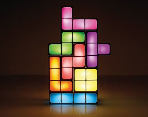 This lamp is many plastic colored pieces put together in the shape of a  tetris game