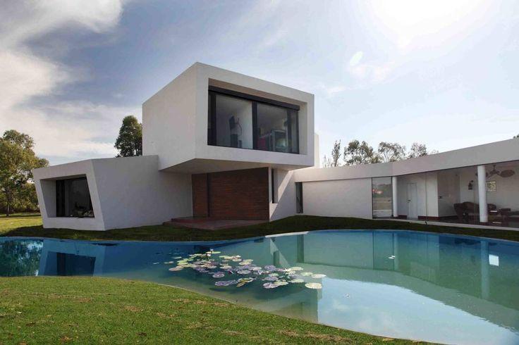 Encontrá las mejores ideas e inspiración para el hogar. Casa Orquidea por Remy Arquitectos | homify