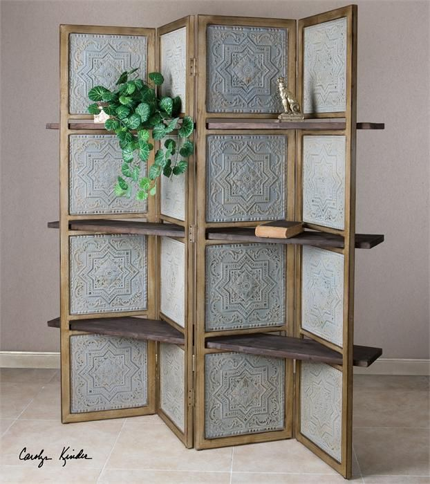ANakaren, Screen with Shelves, Uttermost Four panel screen featuring embossed metal tiles in pale blue with rust undertones and a rustic fir wood frame. Passed between the panels are three wooden shelves in a weathered, barn wood finish. Designer: 	Carolyn Kinder Dimensions: 	70 W X 71 H X 12 D (in)
