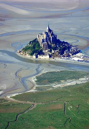 Mont Saint-Michel and its bay are part of the UNESCO list of World Heritage Sites.[2] More than 3,000,000 people visit it each year.