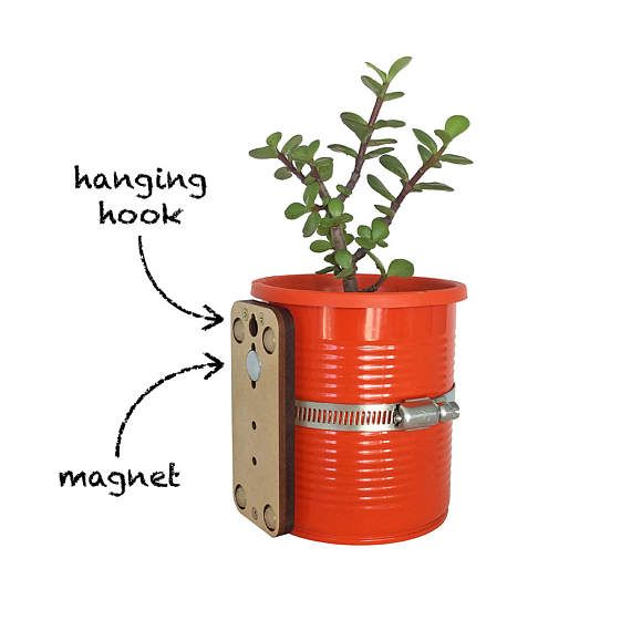 Magnetic self-watering planter.  Magnetised base for attaching to metallic surfaces (fridges, window frames, shelving systems, etc). Can also be hung from the wall using the built-in hanging hook. Available tin colours: white, black, light green, dark green, red, orange, yellow, blue Available plastic pot colours: white, black, light green, dark green, red, orange, purple  Dimensions: 4.65/11.8cm high; 3.95/10cm diameter Weight: 0.62lb/285g  Plant not included.  How to use your...