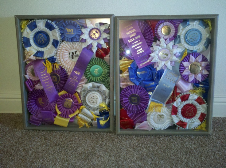 Made these shadow boxes with ribbons won showing cows.  Great way to display winnings from my childhood!!