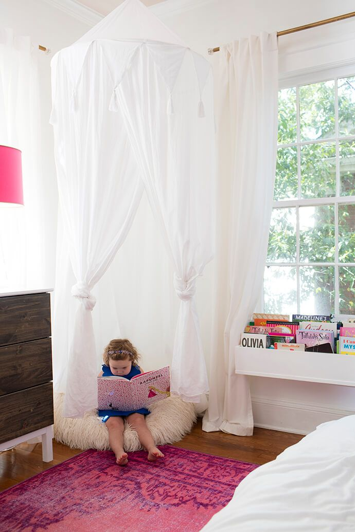 Kids room with a white canopy and