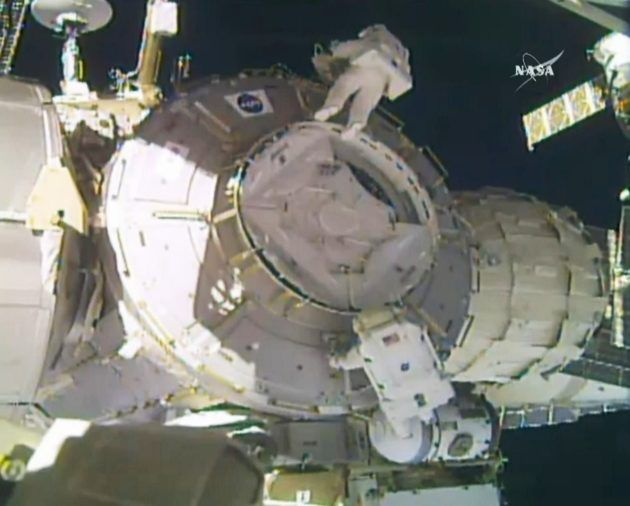 Spacewalkers cope with flyaway cover and NASAs Peggy Whitson sets womens record