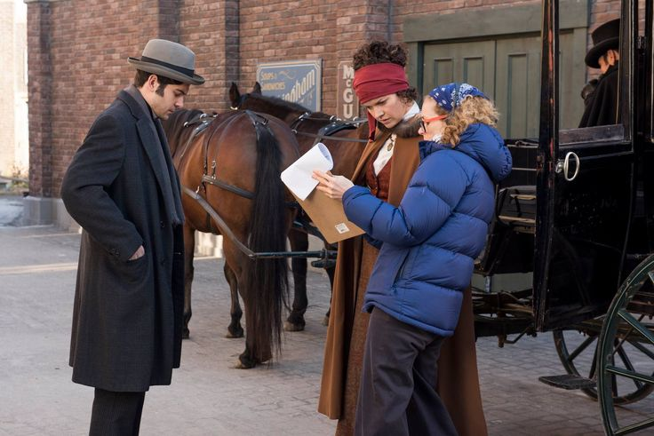 """Daniel Maslany (""""Watts"""") and Elizabeth Whitmere (""""Athena/Clarissa"""") go over the scene with director Leslie Hope."""