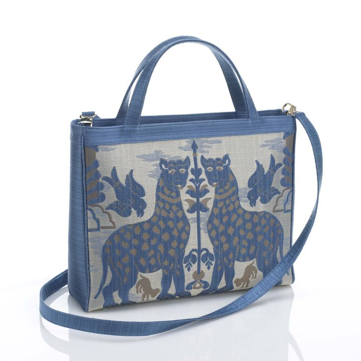 """LAGUNA handbag, made of """"fiere"""" silky brocatel and satin. Embossed satiny lining and wide pockets inside. Discover the bag collection >"""