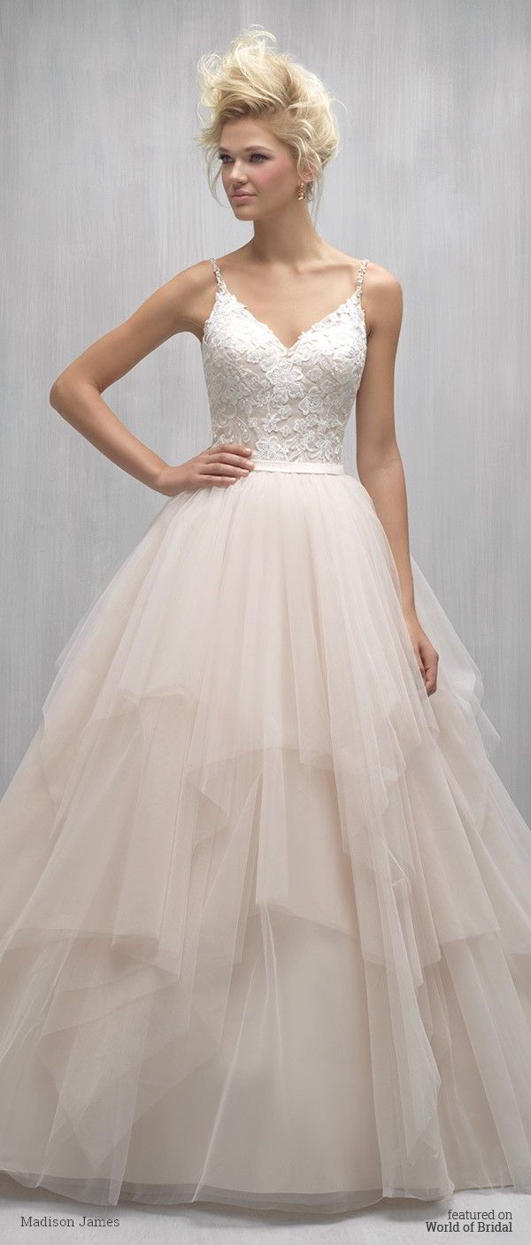 Asymmetrical layers of tulle add an edgy element to this romantic ballgown.