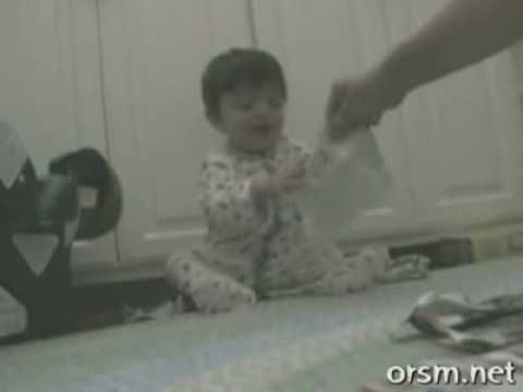 A baby laughing because he's ripping up paper. I love this. At one point, he hasn't even ripped the paper yet, and he just starts cracking up because he knows what's going to happen.