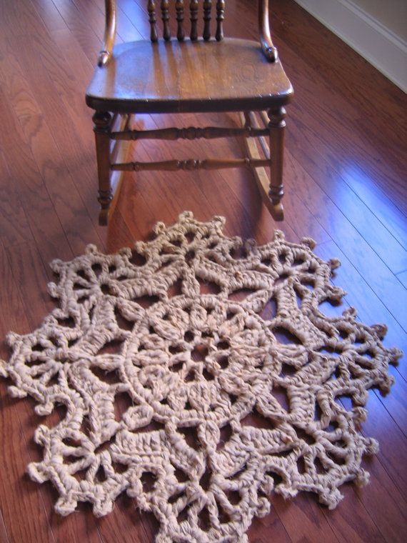 """$5.00 pattern for rag rug made with a set of queen-size bed sheets...reminds me of a snowflake.  Approx 33"""" diameter."""