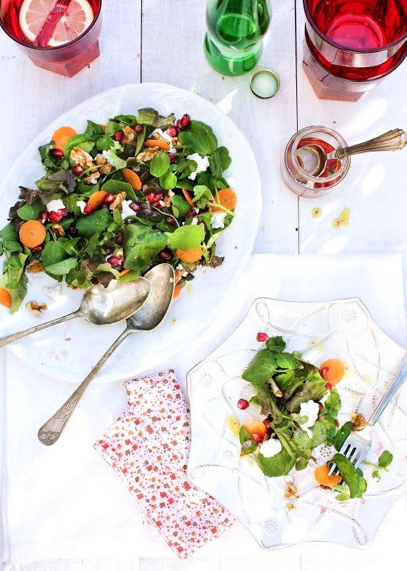 Pomegranate, fresh cheese, carrot, walnuts and green leaves salad