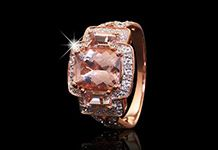 This magnificent morganite trilogy ring is surrounded by diamonds and set in 9ct rose gold.