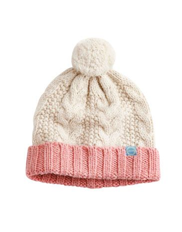 Joules null Mable Cable Bobble Hat, Creme.                     The cold weather is here and has got us talking texture. Soft and warm and stylish, there's no better hat to pull on if you're heading outdoors. Perfect to pair with the Mable Scarf.