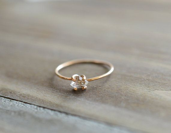 This simple yet gorgeous ring has a spectacular sparkle. A natural Herkimer quartz diamond sits encaged by a 14k gold fill ring with prongs.