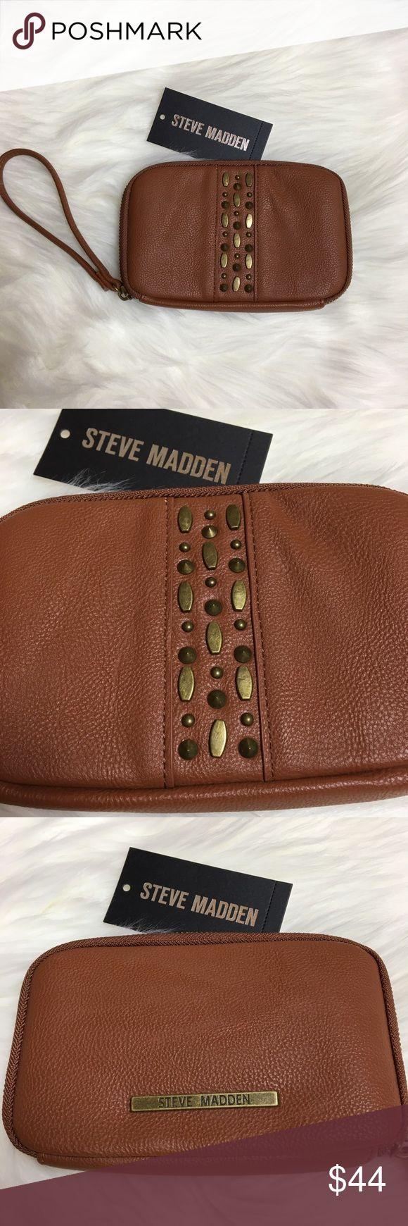 NWT Steve Madden Cognac Faux Leather Wristlet Brand new never used Mini Magnolia by Steve Madden. Color is called cognac. Studded design down center front of wristlet. Wrist strap is not detachable. 4 interior card slots, one clear ID card slot, two billfold sections, one zipper change section and one interior slide pocket. Tags are not physically attached as the plastic used to attached tag was interfering with the zipper, but it has never been used. Tags will be included inside the wallet…