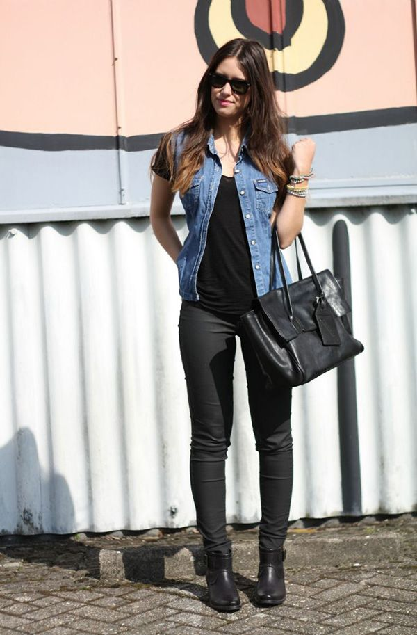 all black everything and blue denim jean vest - black sunglasses, black tshirt or tanktop, black skinny pants, black ankle boots or combat boots, and black purse.