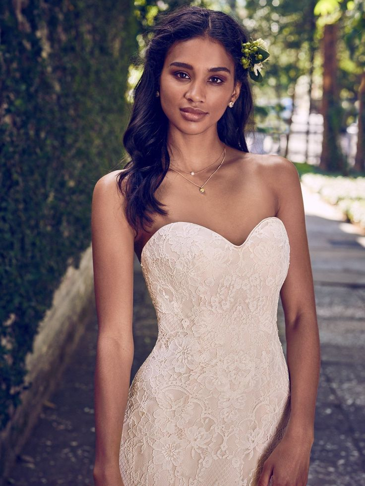 Maggie Sottero - PHILOMENA, This strapless fit-and-flare wedding dress features allover lace and a soft sweetheart neckline. Finished with covered buttons over zipper and inner elastic closure.
